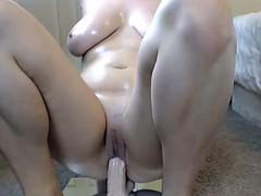 Curvy lady riding dildo hard