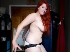 Redhead cubby showing her curves