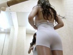 Sexy Asian brunette with a nice ass is unaware she's being