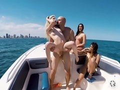 Bikini beauties on the boat have fun sharing his big dick
