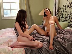 Seductive lesbians playing with their pussies