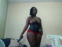 Overweight black momma with big tits plays with her fat pus