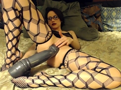 Hottie wearing glasses with two large dildos