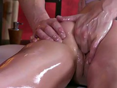 Pussy rubbing for oiled naked brunette