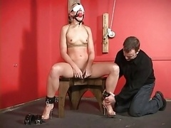 Restrained whore gets dilod in her snatch