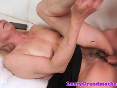 Granny enjoys blowing a fat cock of her lover and then spreads her legs