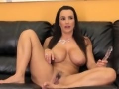 Big tit MILF Lisa poses on the couch and fingers her wet snatch