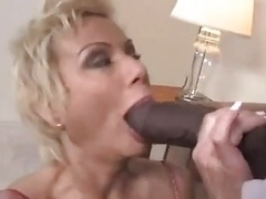 Big-breasted blonde cougar large black fuck pole dick sucking titfuck