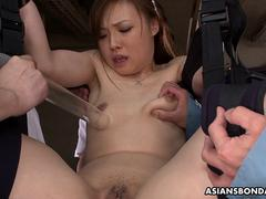 Tied up Asian babe made to squirt with some power