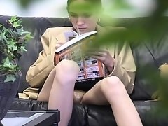 Uninhibited young girl spreads her legs to reveal a shaven