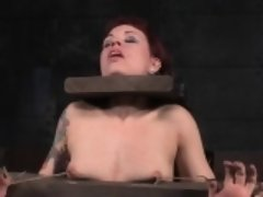 Nipple clamped redhead gets pussytoyed