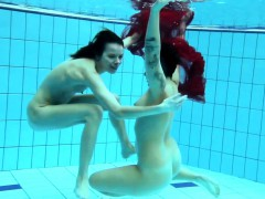 Two underwater girls loving eachother