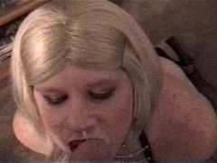 Vintage Carli in leather getting facial cumshot from a white man