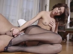 Adorable young European girly in black stockings rides a big dong