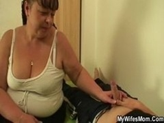 Big-breasted mother in law gives her muff