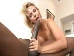 Blonde Brinna Beach takes on Mandingo's extremely large black penis