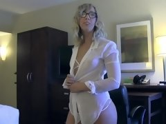 A blonde that has glasses is showing us how she sucks dick