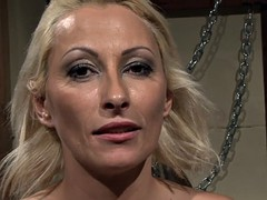 submissive milf deepthroating in bdsm action