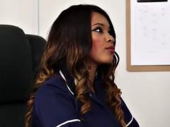 Sexy black nurse helps patient