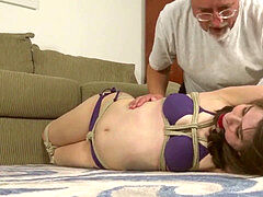 Jeanette trussed and ball-gagged