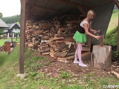Cayla cutting wood and rubbing pussy