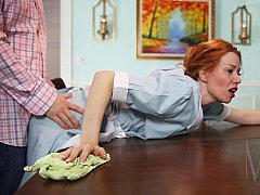 Redhead housemaid fucked on the table